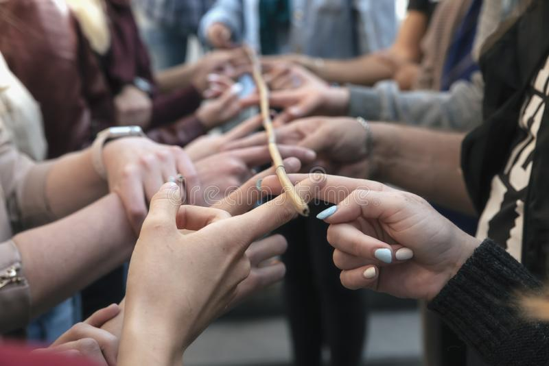 Conceptual image of teamwork, a group of people holding sticks h stock photography