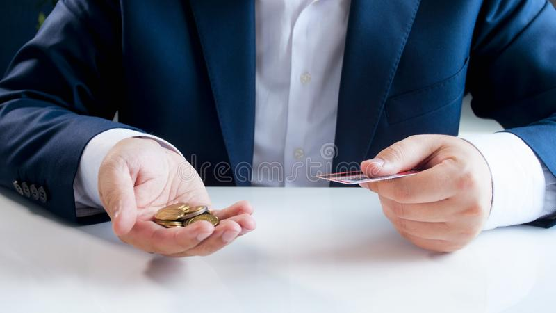 Conceptual photo of using credit cards or metal coins stock photography
