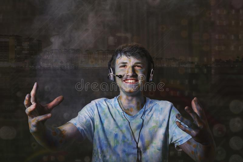 Conceptual image of a young smiling person who uses computer technology to communicate with the outside world. Conceptual image of a young smiling person who royalty free stock photography