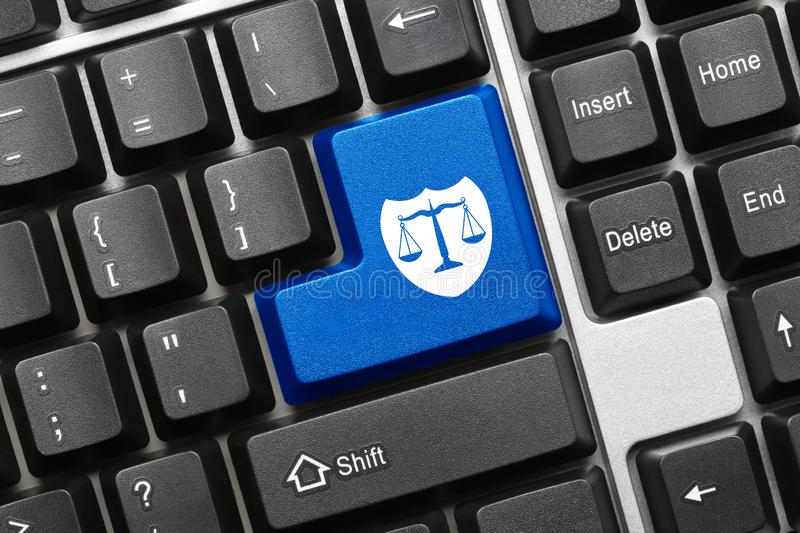Conceptual keyboard - Blue key with shield and scales symbol. Close-up view on conceptual keyboard - Blue key with shield and scales symbol stock photos