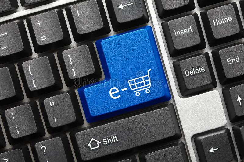 Conceptual keyboard - e-shop symbol blue key. Close-up view on conceptual keyboard - e-shop symbol blue key stock photo