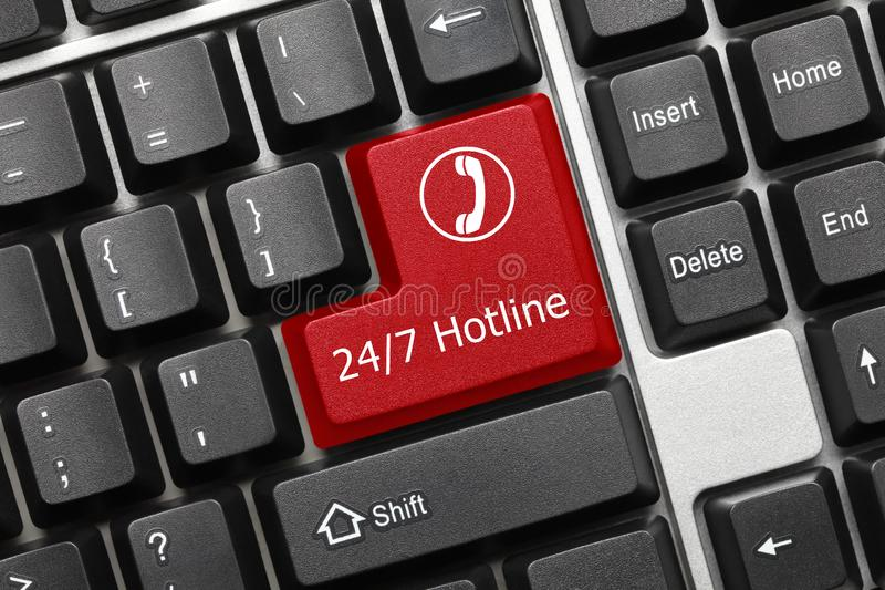 Conceptual keyboard - 24/7 Hotline red key with phone symbol. Close-up view on conceptual keyboard - 24/7 Hotline red key with phone symbol stock image