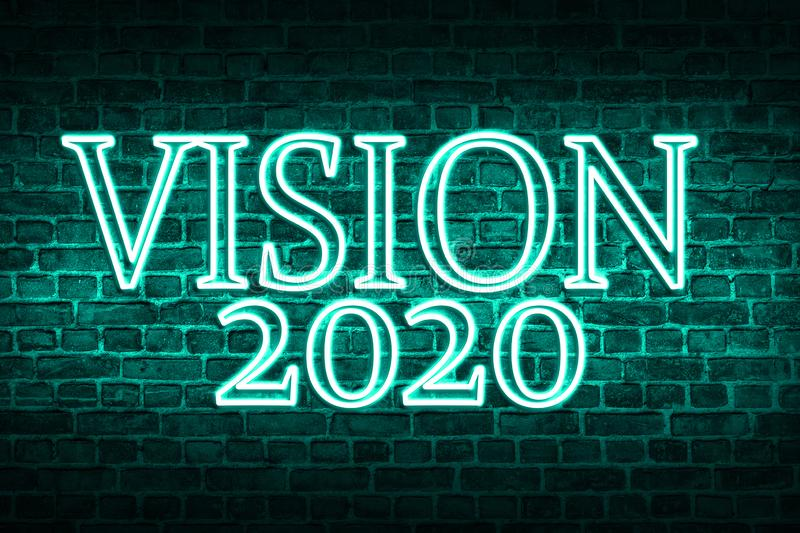 A conceptual message written by the neon light on the wall shows `vision 2020`. Business motivation, inspiration concepts ideas.  royalty free stock photo