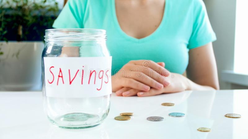 Conceptual image of bankruptcy. Woman with empty glass jar for money savings royalty free stock photos