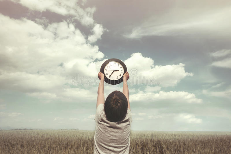 Conceptual photo of little boy and the relativity of time stock image