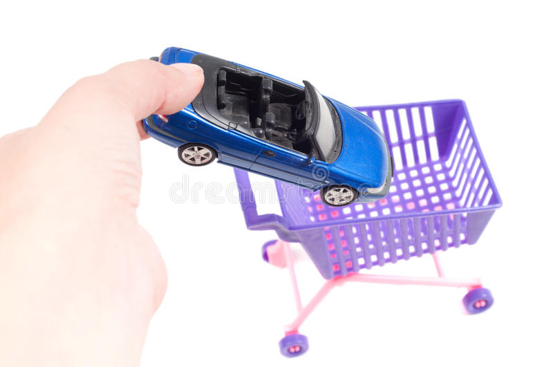 Conceptual Photo With Car And Shopping-cart Stock Photos