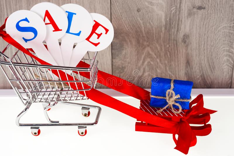 Conceptual photo of Christmas sales or gift shopping. The word SALE royalty free stock photo