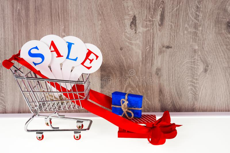 Conceptual photo of Christmas sales or gift shopping. The word SALE royalty free stock images