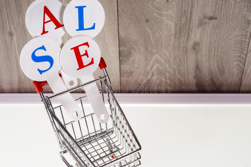 Conceptual photo of Christmas sales or gift shopping. The word SALE royalty free stock image