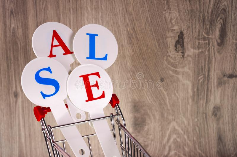 Conceptual photo of Christmas sales or gift shopping. The word SALE stock photography