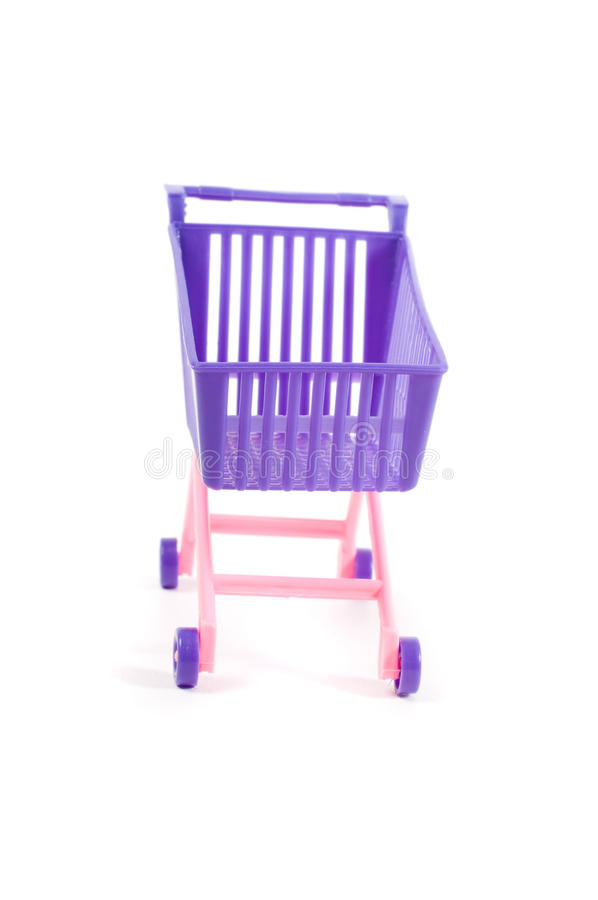 Conceptual photo with miniature shopping-cart royalty free stock image