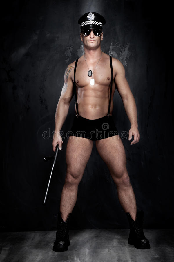 Conceptual photo of muscular, good looking police officer over t. Conceptual photo of young, and good looking police officer, almost naked royalty free stock photography