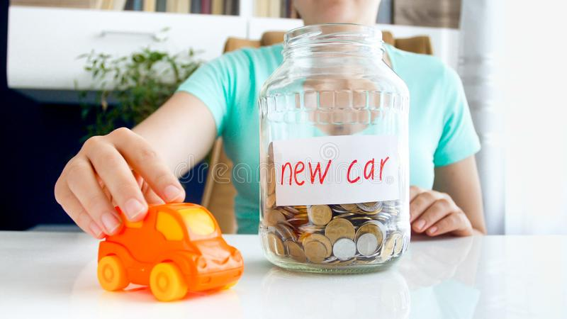 Conceptual image of saving money or taking bank loan for purchasing new car. Conceptual photo of saving money or taking bank loan for purchasing new car stock photography