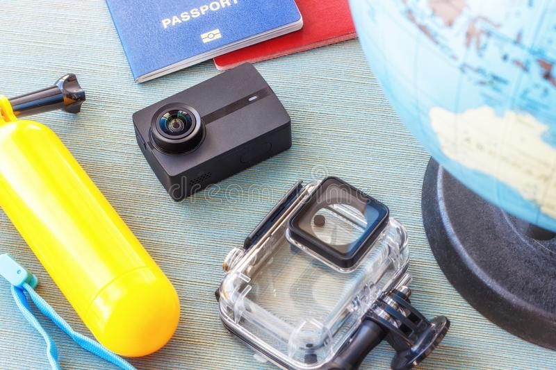 Conceptual photography of tourism, action camera, planning a trip with a card, passport, mobile phone and camera action royalty free stock photos