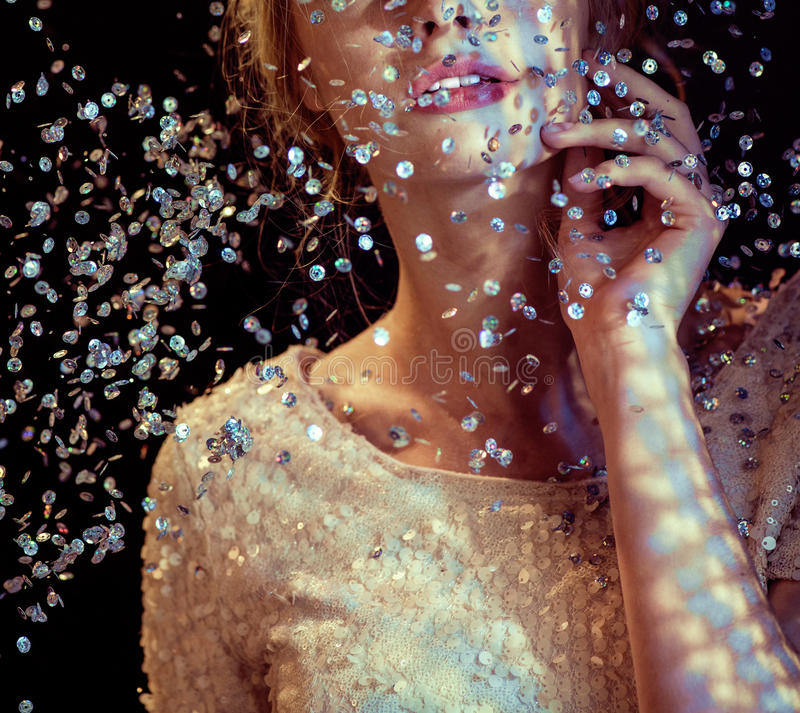 Conceptual picture of a woman looking at the sequin rain. Conceptual picture of a lady looking at the sequin rain royalty free stock images
