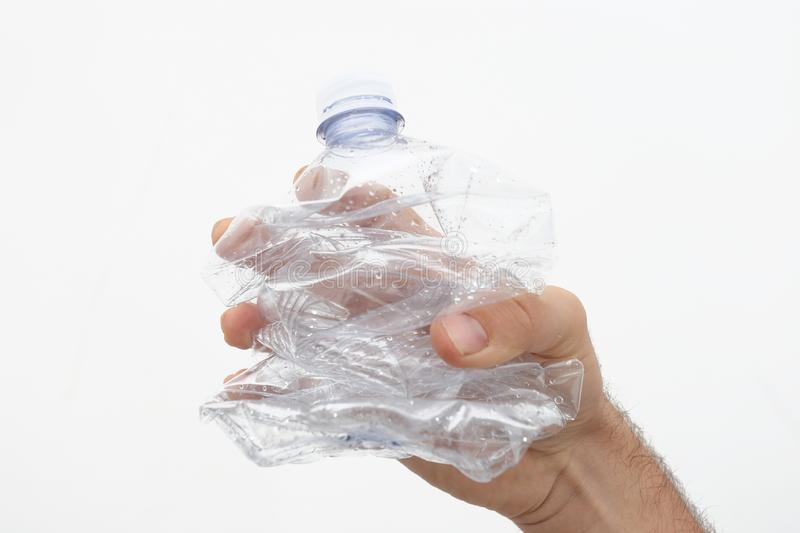 conceptual plastic free photo - the plastic bottle held in the hand stock images