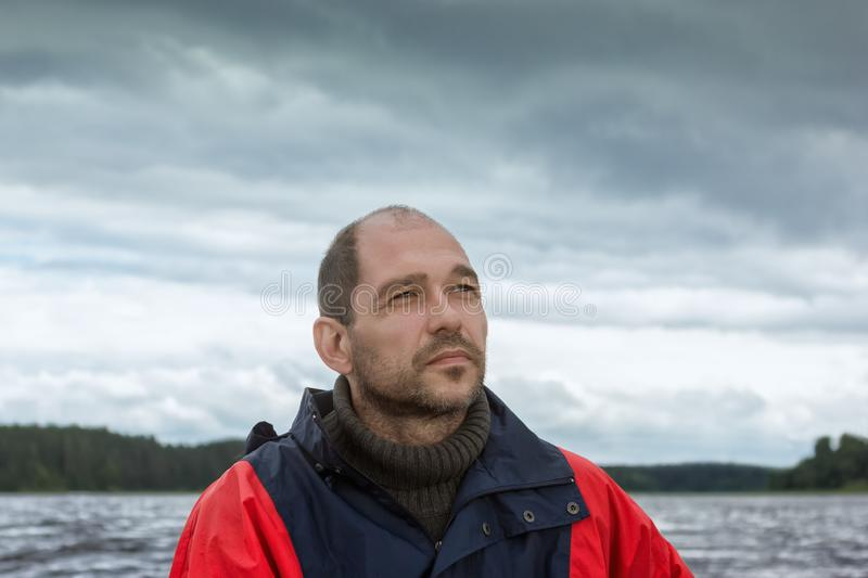 Conceptual Portrait Of A Bearded Man Against A Overcast Sky royalty free stock photo