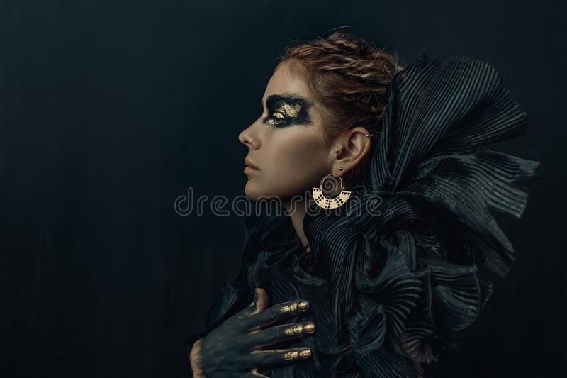 Conceptual portrait of beautiful fashion look woman dark make up stock photos