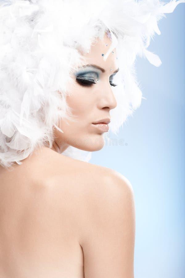 Conceptual portrait of woman in winter makeup