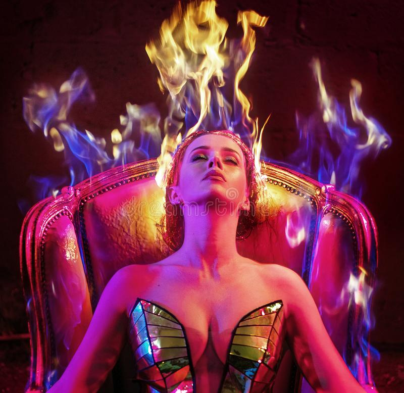 Conceptual portrait of a woman with flame haircut stock photo