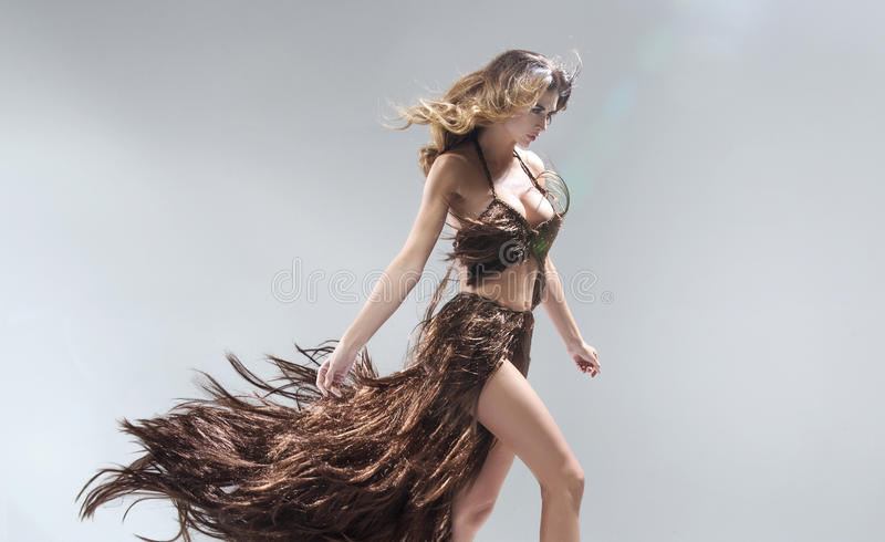 Conceptual portriat of the woman wearing dress made of hair royalty free stock photo