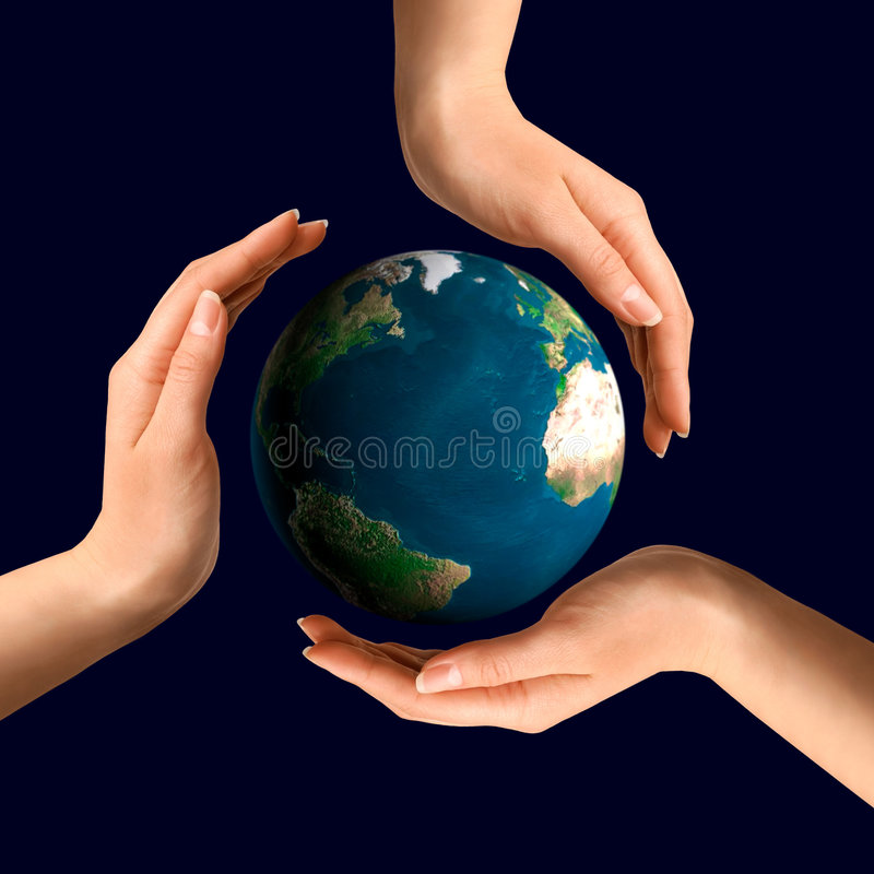 Conceptual Recycling Symbol. Made from hands over Earth globe Environment and ecology concept stock images