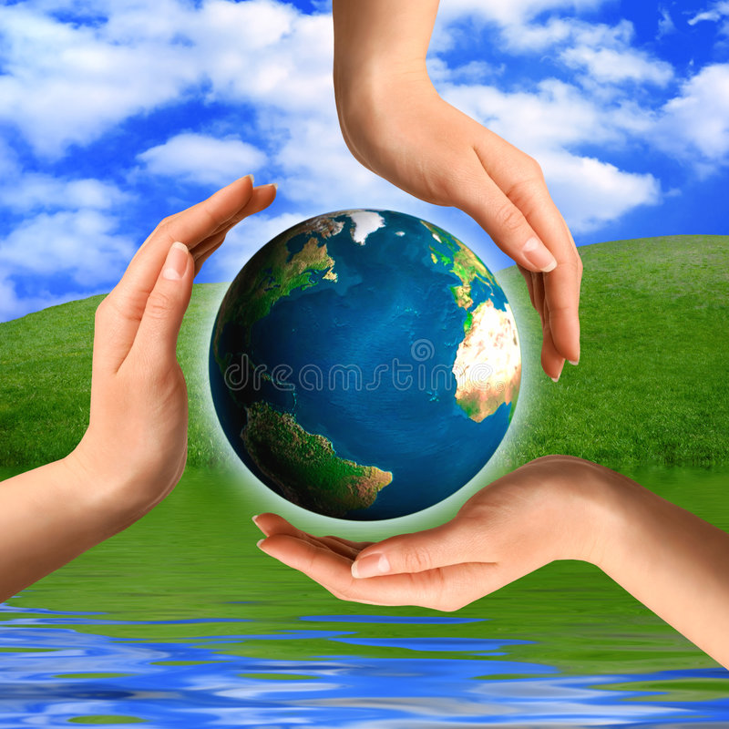 Conceptual Recycling Symbol. Made from hands and a small Earth globe Environment and ecology concept stock photo