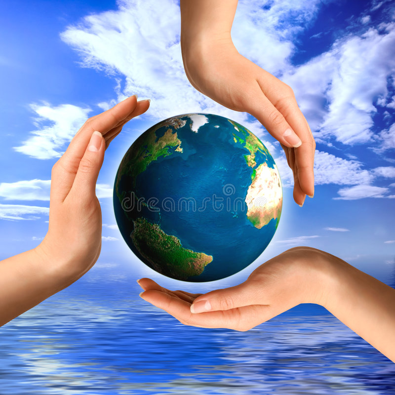 Conceptual Recycling Symbol. Made from hands and a small Earth globe Environment and ecology concept stock photos