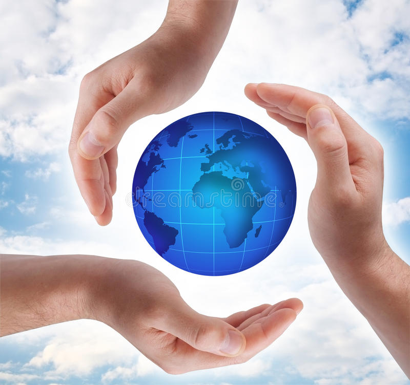 Conceptual safety symbol made from hands. Over globe royalty free stock image