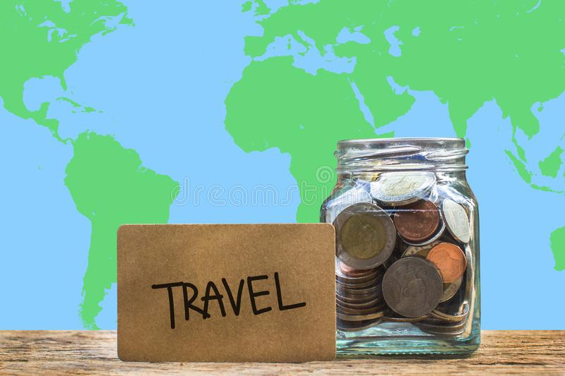 Conceptual saving money for travel with world map as background. stock image