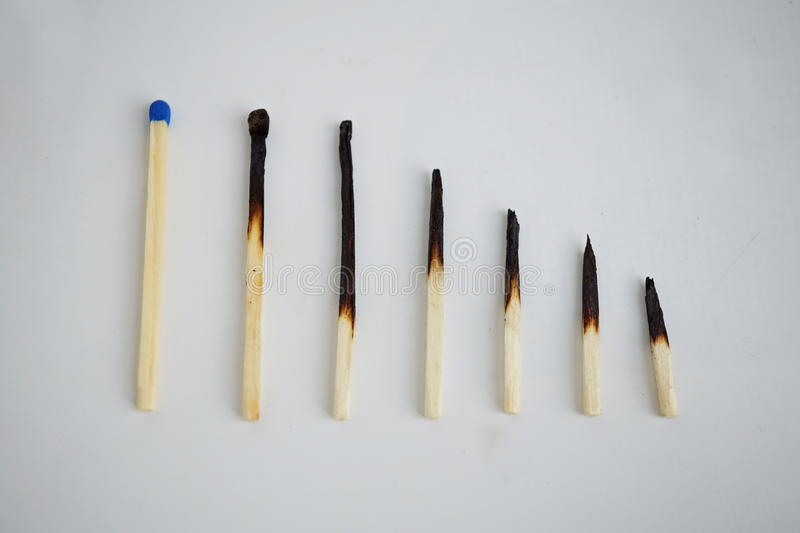 Conceptual set of burnt matches gradually arranged by stages of their incineration stock images