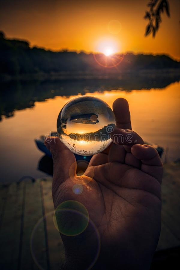 Conceptual shot with a hand holding a lensball used for reversed royalty free stock image