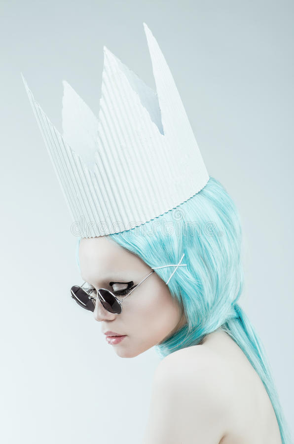 Conceptual studio portrait of woman with cyan hair. Conceptual studio portrait of woman with cyan wig stock image