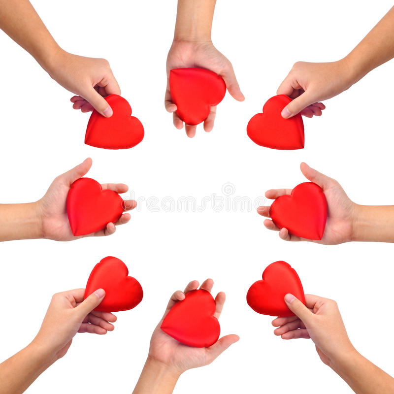 Conceptual symbol of love. Hand with heart isolated on white with a copy space in the middle stock photos