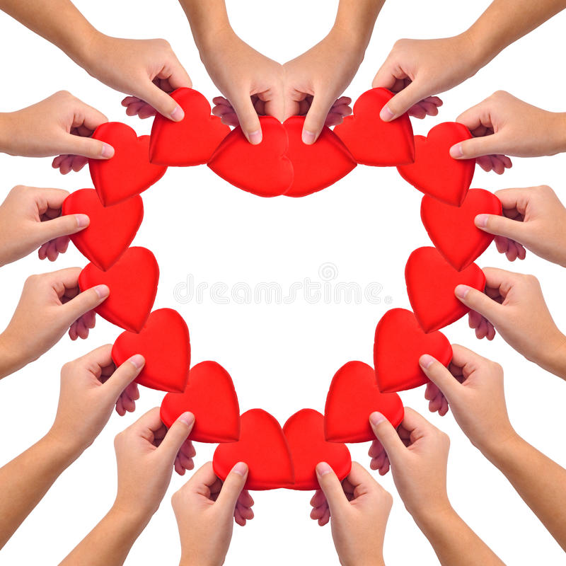 Conceptual symbol of love. Hand with heart isolated on white with a copy space in the middle stock image