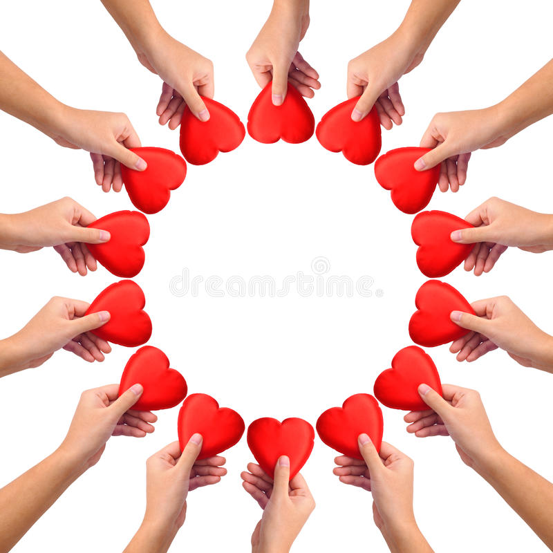 Conceptual symbol of love. Hand with heart isolated on white with a copy space in the middle royalty free stock image