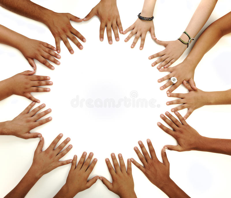 Conceptual symbol of multiracial children hands. Making a circle on white background with a copy space in the middle stock photo
