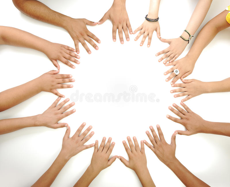Conceptual symbol of multiracial children hands. Making a circle on white background with a copy space in the middle stock images