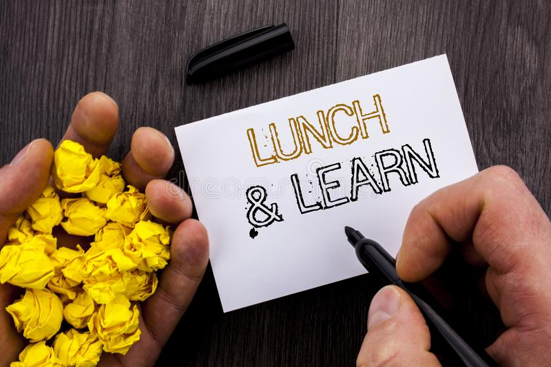 Conceptual text showing Lunch And Learn. Business photo showcasing Presentation Training Board Course written on Notebook Book Man. Conceptual text showing Lunch royalty free stock image