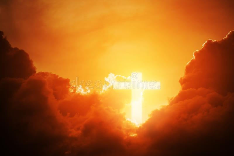 Conceptual wood cross or religion symbol shape over a sunset sky with clouds background for God. Belief or resurrection of god and worship christian royalty free stock image