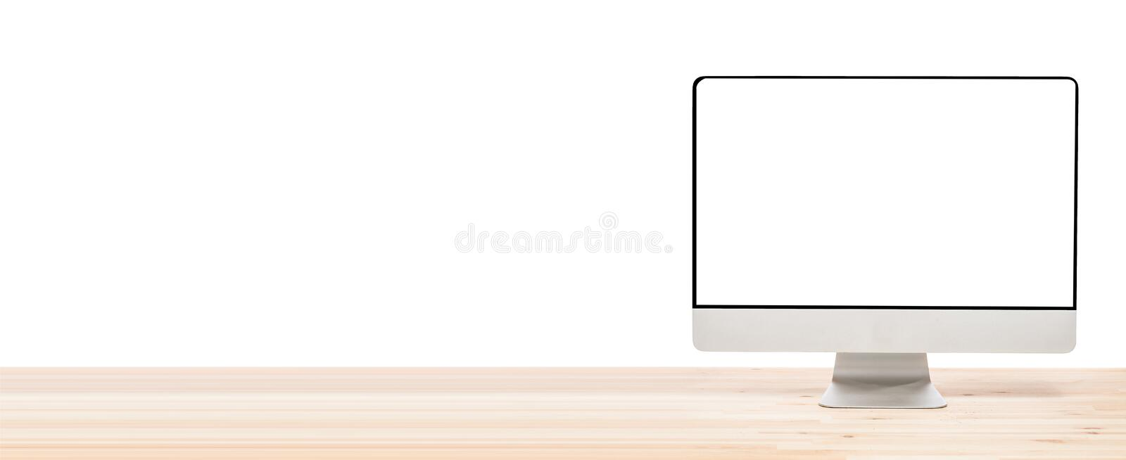 Conceptual workspace or business concept. Big computer monitor display with blank white screen on light wooden table. Isolated stock image