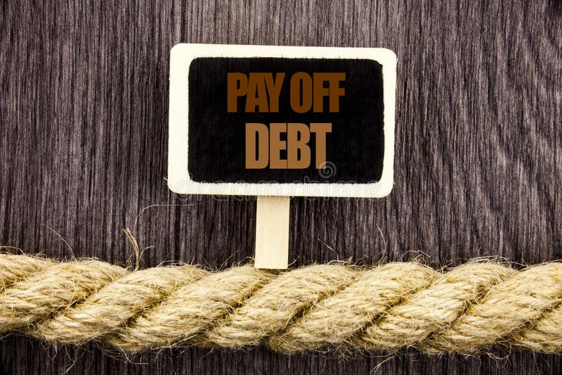 Conceptual writing text showing Pay Off Debt. Business photo showcasing Reminder To Paying Owed Financial Credit Loan Bills writte. N Blackboard Hanging rope royalty free stock photos