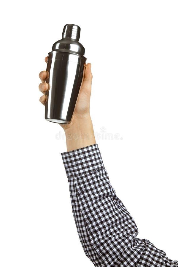 Conceptueel beeld van de barman De hand houdt een schudbeker op een witte achtergrond wordt geïsoleerd die stock foto