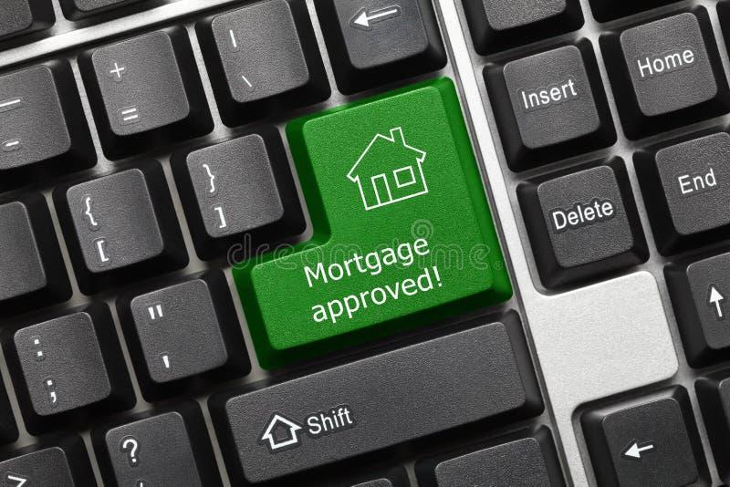 Conceptueel toetsenbord - Hypotheek goedgekeurde groene sleutel royalty-vrije stock foto