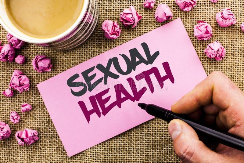 Conceptuele hand die tonend Seksuele Gezondheid schrijven STD van de bedrijfsfototekst van de Beschermings het Gezonde Gewoonten  royalty-vrije stock foto's