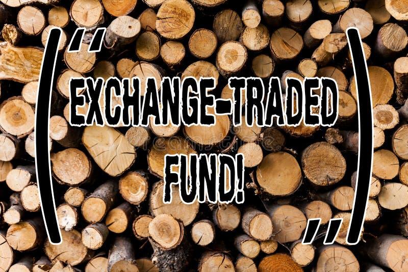 Conceptuele hand die tonend Uitwisseling Verhandeld Fonds schrijven Bedrijfsfoto die Verkoopbare veiligheid demonstreren die een  stock afbeelding