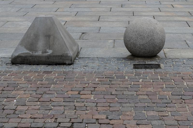 Concerete sphere and triangle prohibiting parking, parking security barrier. Image stock image
