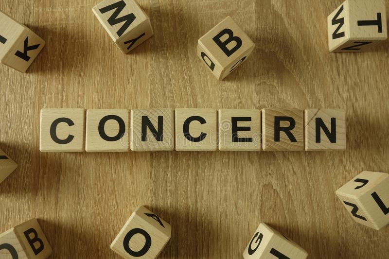 Concern word from wooden blocks royalty free stock photo