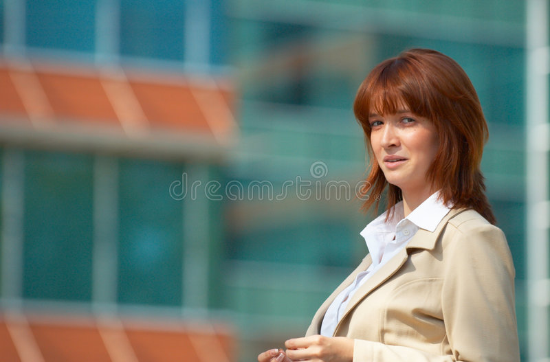 Concerned Business Woman. Young business woman with a concerned expression, standing outside an office building royalty free stock photography