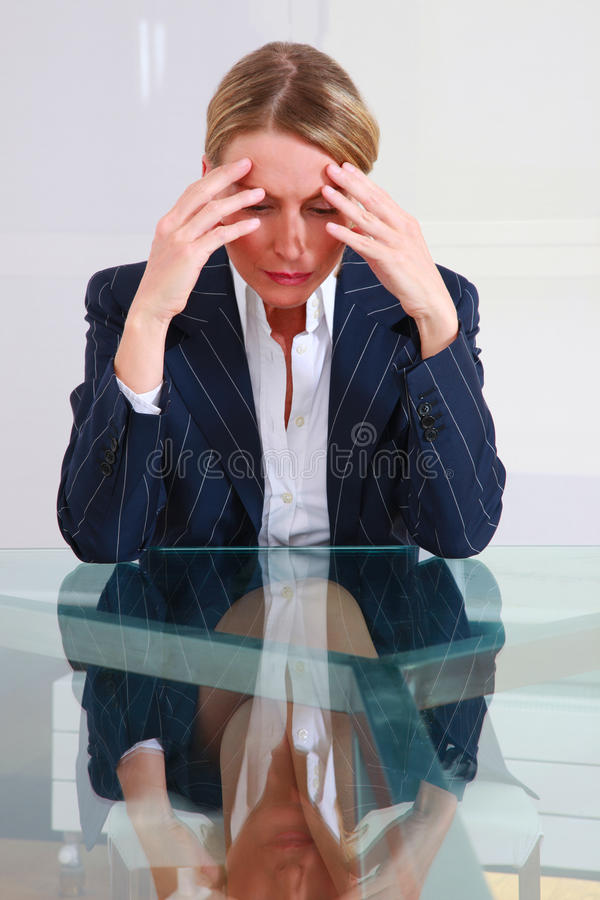 Concerned businessman in office stock photos